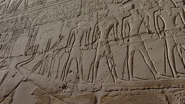 karnak temple complex. pan right on relief of the gods anubis, khnum, horus and seth and pharaoh dragging a boat. - pharaoh stock videos & royalty-free footage