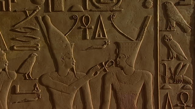 karnak temple complex. the god min wearing the double crown putting an ankh near pharaoh's mouth. - pharaoh stock videos & royalty-free footage