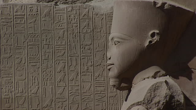 karnak temple complex view of a statue of pharaoh in profile - archaeology stock videos & royalty-free footage