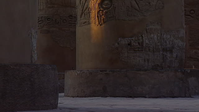 karnak temple complex. view of column bases in the great hypostyle hall in the precinct of amon re. - orthographic symbol stock videos & royalty-free footage