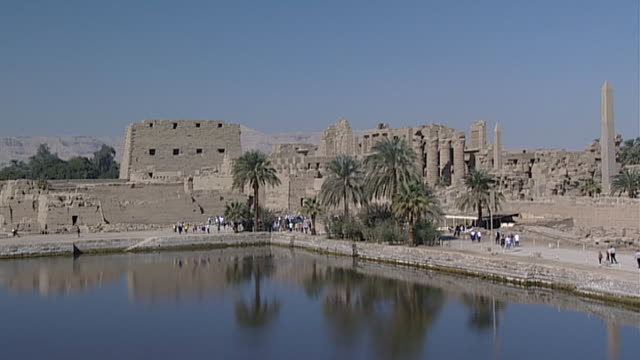 karnak temple complex. view of sacred lake. - spirituality stock videos & royalty-free footage