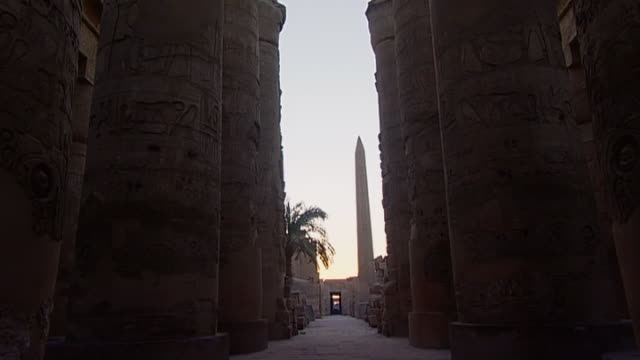 karnak temple complex. view of the great hypostyle hall in the precinct of amon re. - orthographic symbol stock videos & royalty-free footage