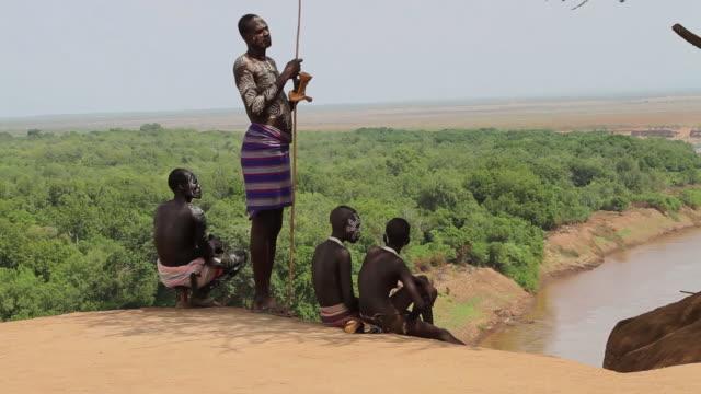 Karo tribe boys near the Omo river painted in white traditional bodyart Omo valley Ethiopia