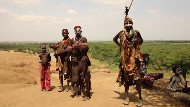 Karo tribe people with traditional clothings near the Omo river Ethiopia