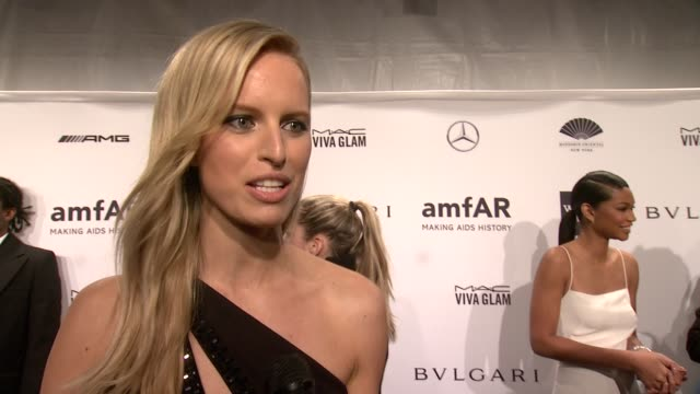 interview karolina kurkova on what makes amfar such a special organization and on what she's most looking forward to tonight amfar new york gala 2014... - karolina kurkova stock videos and b-roll footage