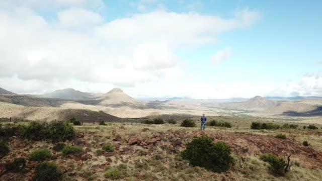 Karoo Farmer looks over his farm