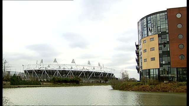 karren brady criticises tottenham hotspur plans for olympic stadium t21011101 / 2112011 olympic stadium seen across river lea with flats on right... - カレン ブラディ点の映像素材/bロール