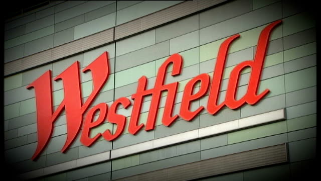 karren brady criticises tottenham hotspur plans for olympic stadium r30100806 shepherd's bush seq shoppers in westfield shopping centre / shopping... - カレン ブラディ点の映像素材/bロール