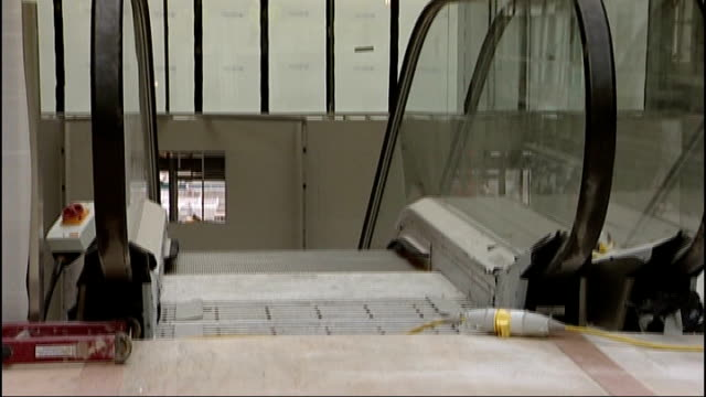 karren brady criticises tottenham hotspur plans for olympic stadium escalators pan up to view of olympic stadium through window olympic stadium seen... - カレン ブラディ点の映像素材/bロール
