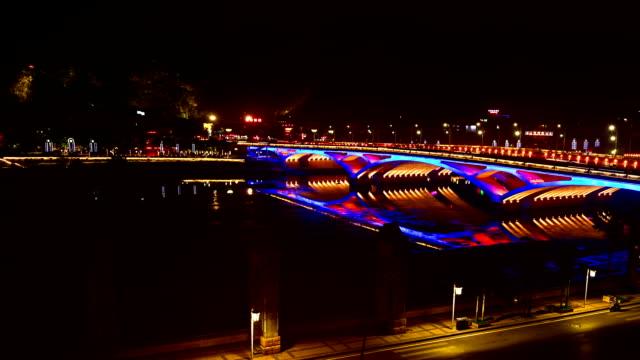 karst peaks,li river and the bridge at night - li river stock videos & royalty-free footage