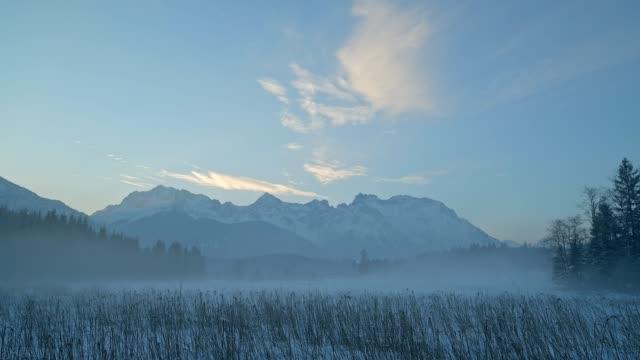 karwendel mountainrange on morning in winter, krün, garmisch-partenkirchen upper bavaria, bavaria, germany, european alps - garmisch partenkirchen stock videos & royalty-free footage