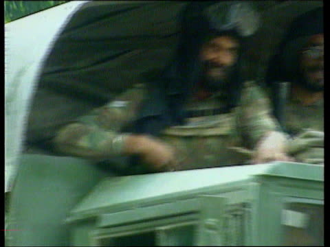kashmir militants hold western hostages itn lib f'back indian troops in lorry as along soldiers in street - jammu e kashmir video stock e b–roll