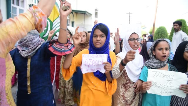 kashmiri muslims hold banners and shout pro freedom slogans during a protest in srinagar kashmir on september 14 2019 frustration anger and fear have... - jammu e kashmir video stock e b–roll