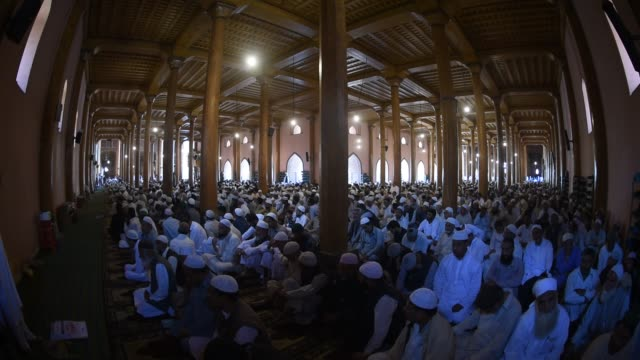 Kashmiri Muslims listen to the sermon inside the Grand Mosque on the last Friday of the holy Islamic month of Ramadan on May 31 2019 in Srinagar the...