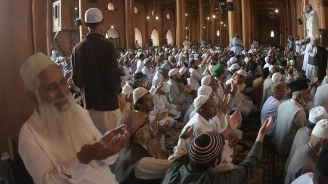 kashmiri muslims listen to the sermon inside the grand mosque on the last friday of the holy islamic month of ramadan on may 31 2019 in srinagar the... - grand mosque stock videos and b-roll footage
