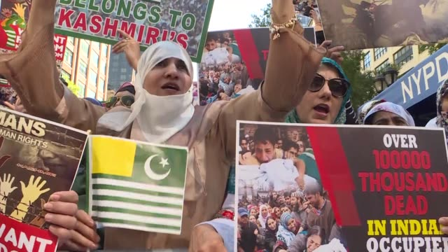 kashmiri people who, continue to sustain their lives in the united states, gather to against the revoke of controversial article 370 by indian... - reportage stock-videos und b-roll-filmmaterial
