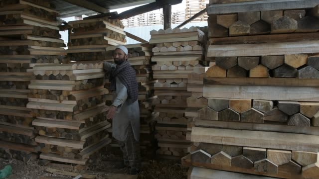 kashmiri workers arrange willow clefts before rough shaping them into cricket bats in a factory on june 08 2019 in halmullah 50 km south of srinagar... - durability stock videos & royalty-free footage