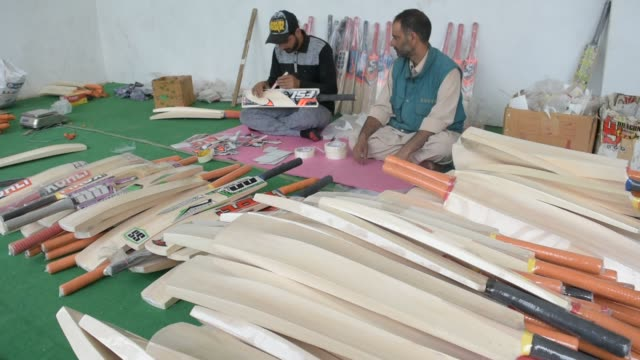 kashmiri workers paste labels on the finished cricket bats in a factory on june 08, 2019 in halmullah, 50 km south of srinagar, the summer capital of... - durability stock videos & royalty-free footage