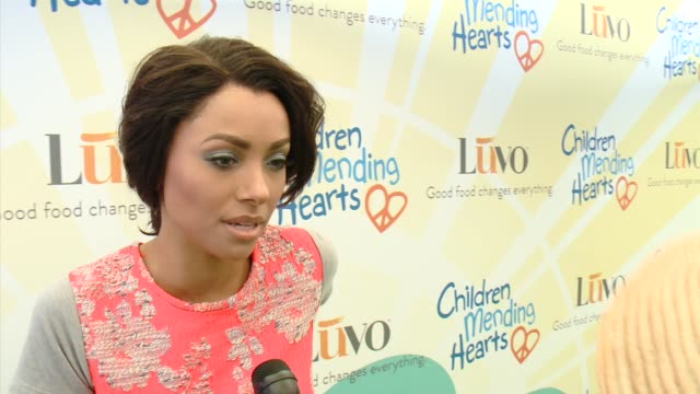 kat graham on being honored with the cast of heroes award, what she appreciates about children mending hearts, her plans for the 4th of july at... - short sleeved stock videos & royalty-free footage