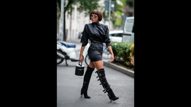 vídeos de stock e filmes b-roll de kat graham wearing black dress, black boots, and bucket bag alessandra rich and giuseppe zanotti is seen during milan fashion week spring/summer 2019... - vestido preto