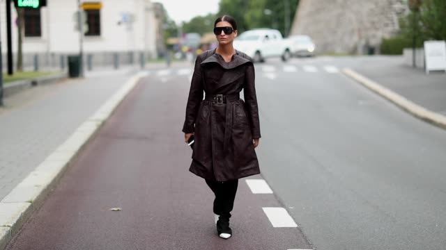 Katarina Petrovic wearing leather coat and flared pants is seen outside the Moire show during Oslo Runway SS19 on August 15 2018 in Oslo Norway