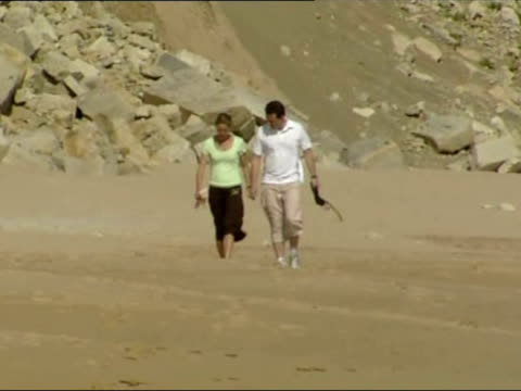 Kate and Gerry McCann parents of Madeleine McCann walk along beach in the Algarve Kate Gerry McCann Walk Along Beach at Praia de Luz on May 13 2007...