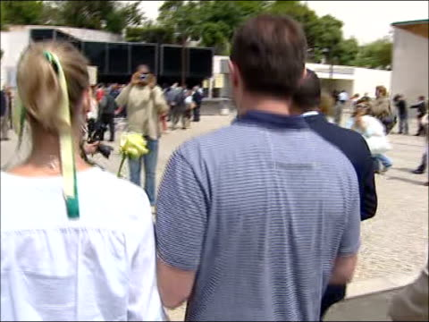 kate and gerry mccann visit holy shrine to pray for their daughter; portugal: santarem: fatima: ext * * voice-over of reporter speaking heard... - hair back stock videos & royalty-free footage