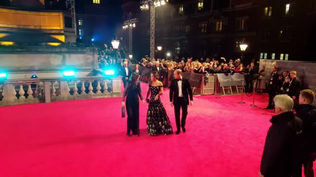 stockvideo's en b-roll-footage met kate and will arrive on the red carpet for the 2017 bafta film awards the duke and duchess are greeted with applause as they enter royal albert hall... - bafta awards