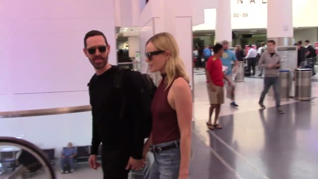 kate bosworth and michael polish arriving at lax airport in los angeles in celebrity sightings in los angeles - kate bosworth stock-videos und b-roll-filmmaterial