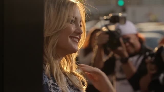 kate hudson posing for paparazzi on the red carpet at the arclight cinerama dome - profile stock videos & royalty-free footage