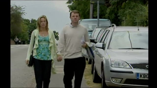kate mccann and gerry mccann along from church after service - disappearance of madeleine mccann stock videos & royalty-free footage