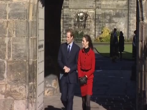 kate middleton accepts flowers as she and her fiancee prince william embark on a walkabout during their second official visit together at st andrews... - st. andrews scotland stock videos & royalty-free footage