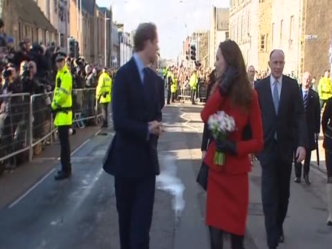 kate middleton and her fiancee prince william embark on a walkabout during their second official visit together at st andrews university where they... - st. andrews scotland stock videos & royalty-free footage