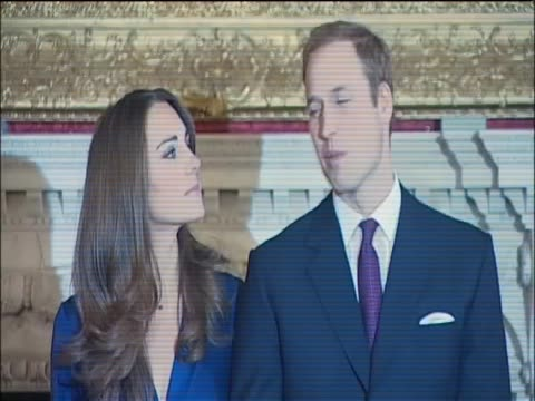 Kate Middleton and Prince William enter press conference at St James's palace and stand before flashing lights of photographers having announced...