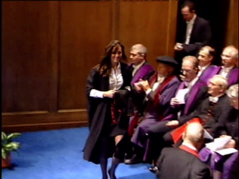 kate middleton kneels to receive cap and gown at graduation ceremony university of st andrews 23 june 2005 - graduation gown stock videos and b-roll footage