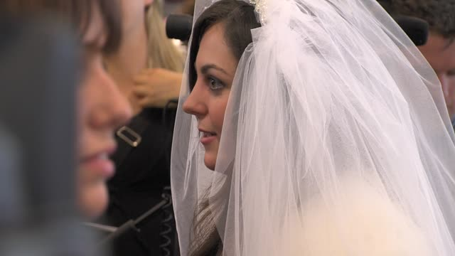 kate middleton lookalike at the kate & wills up the aisle book launch at london england. - インタビュー素材点の映像素材/bロール