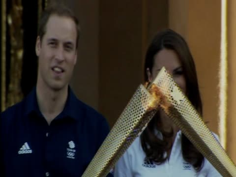 kate middleton prince william and prince harry watch the olympic torch relay - flaming torch stock videos & royalty-free footage