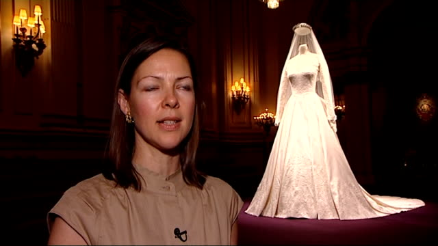 kate middleton wedding dress goes on display caroline de guitaut interview sot - wedding dress stock videos & royalty-free footage