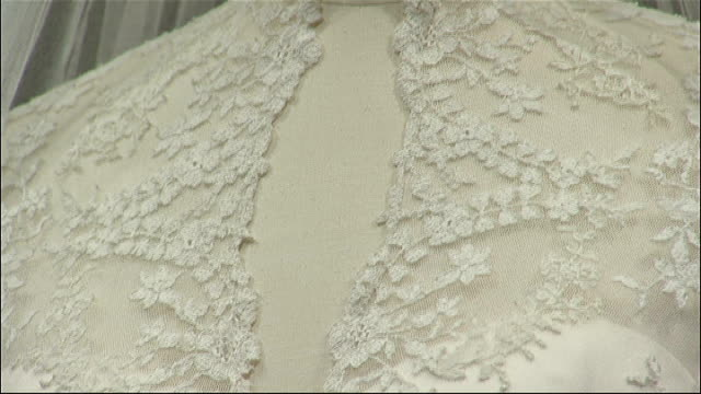 Kate Middleton wedding dress goes on display Close shots showing detail of embroidery on dress ** De Guitaut interview overlaid SOT **