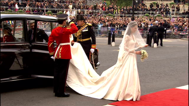 Kate Middleton wedding dress goes on display LIB London Westminster Abbey EXT Kate Middleton Duchess of Cambridge out of car in wedding dress and...