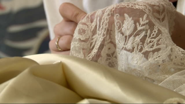 kate middleton wedding dress goes on display london close shots of dressmakers stitching lace rachel doyle and sophie long interview sot - wedding dress stock videos & royalty-free footage