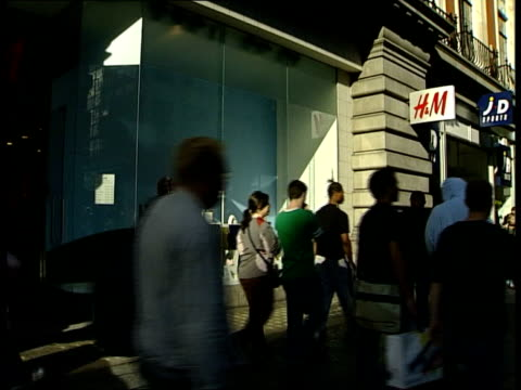 Kate Moss dropped from HM advertising campaign ENGLAND London Oxford Street M sign over store Shoppers along thru doors People walking past Hennes...