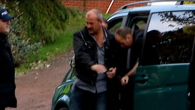 stockvideo's en b-roll-footage met husband confesses cutaway redmarley prout from car handcuffed to police officer - bewegingsbeperkende middelen