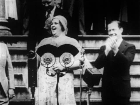 kate smith standing at microphone singing / clapping mayor mckee stands by / nyc / newsreel - 1931 stock videos & royalty-free footage