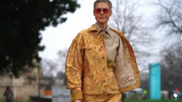 kate tik wears aviator sunglasses a gray shirt a yellow and orange floral print jacket shorts fishnet tights a brown and yellow crocodile pattern... - tights stock videos & royalty-free footage