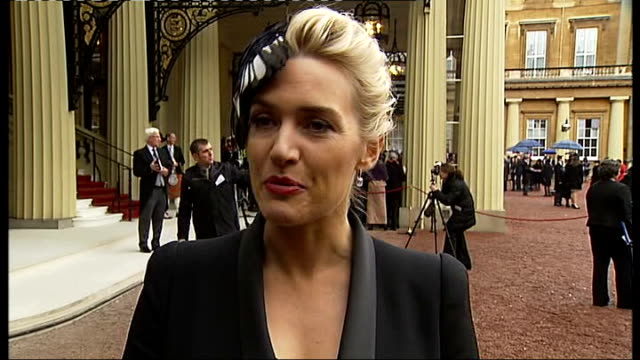 kate winslet darren clarke and anna kennedy receive honours from the queen kate winslet along and interview sot side views winslet speaking to press... - kate winslet stock-videos und b-roll-filmmaterial