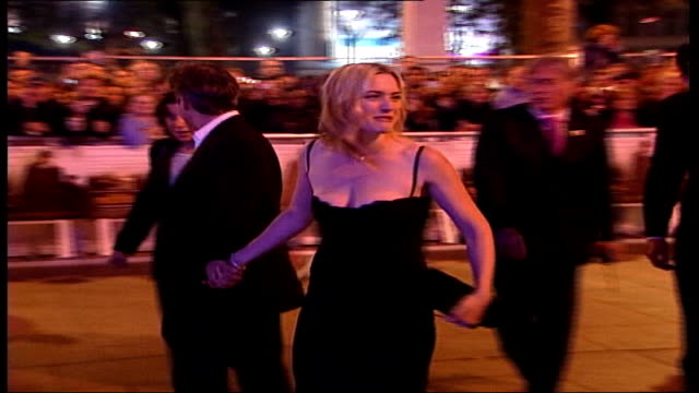 kate winslet marries sam mendes evening london actress kate winslet and director sam mendes arriving at film premiere pan ms winslet and mendes... - kate winslet stock videos and b-roll footage