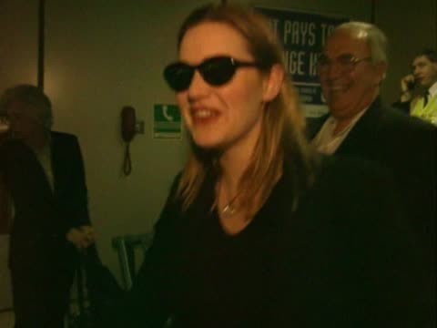 kate winslet walks through heathrow with first husband jim threapleton after returning from oscars where she failed to get an oscar for her role in... - kate winslet stock videos & royalty-free footage