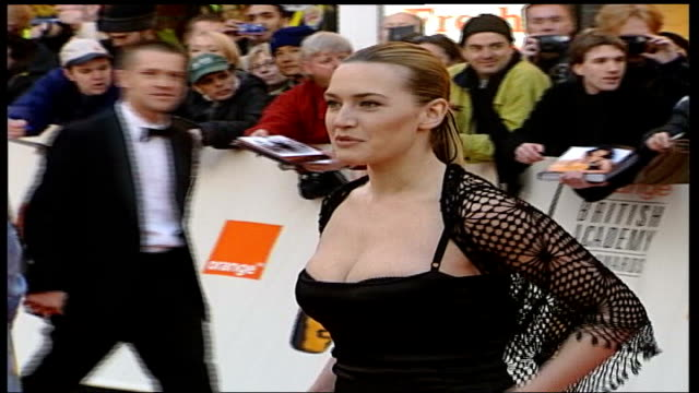 kate winslet wins high court battle against grazia magazine date photography winslet arriving for bafta awards ceremony and posing for photographers - kate winslet stock videos and b-roll footage