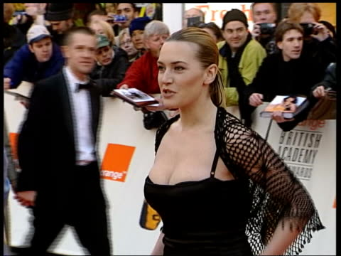 Kate Winslett new image NEWS London Kate Winslett wearing black dress and crocheted top arriving at BAFTA awards PAN as stops for photocall CS...